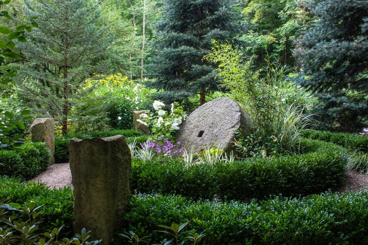 Millstones in the Garden, Thinking Outside the Boxwood, Miriam's River House Designs